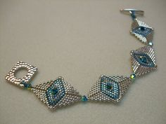 http://laurasbeads.com/images/classes/intermediate/silver_bracelet.jpg; great ideas for triangles