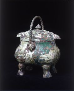 Ritual wine vessel in the shape of 2 owls, xiaoyou Date: Shang Dynasty, C.1500 - 1050 BC