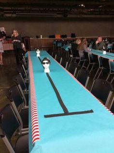 Cute swim banquet idea- swim lanes minus the creepy heads Swimming Cake, Night Swimming, Swimming Diving, Scuba Diving, Swim Coach Gifts, Swim Team Gifts, Swim Team Party, Pool Pool, Team Dinner