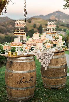 Dessert table on wooden barrels