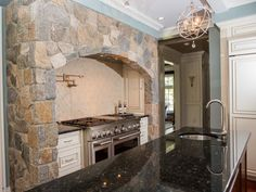 Boston Blend Mosaic Thin Veneer surrounds oven and stove in the heart of the kitchen Stone Kitchen, Kitchen Stove, Stone Columns, Cooking Stove, Stone Veneer, Cool Things To Make, Home Remodeling, New England, Boston