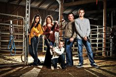 Great family pic featuring a barn, horse stable, etc