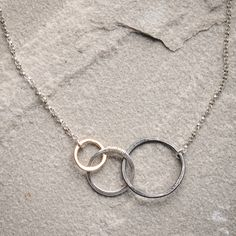 Freshie and Zero Storied Necklace-Life's just one big story. Celebrate your story with the Storied necklace by Freshie and Zero. Three hoops hooked together remind you of your beginning, middle, and end. Take hope that even at the climax of the conflict, there's always a resolution on the next page.