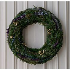 wire wreath. put anything on it (lights, cards, flowers) @CB2