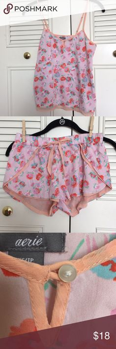 Aerie sleep set Pink/peach floral aerie sleep set—both top and bottoms come in this set. Both XS. Silky material; bottom is lined, and top has adjustable straps. Both are in excellent used condition with no apparent flaws. Absolutely adorable. It breaks my heart that I've grown out of this set so I'm hoping to find someone who loves it as much as I do. Both are 100% polyester. aerie Intimates & Sleepwear Pajamas