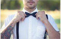 Edgy groom wears bow tie