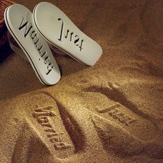 The sand imprint of the Beach Wedding Just Married Flip Flop Wedding Favors. Available @CL in white for the bride and black for your groom