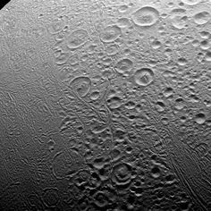 The north polar area of Enceladus (313 miles or 504 kilometers across) seen here is heavily cratered, an indication that the surface has not been renewed since quite long ago.