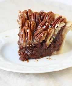 This Salted Caramel Chocolate Pecan Pie is rich and decadent! The addition of chocolate is phenomenal with the toasted pecans, and the salted caramel topping really sets it apart! Add a scoop of vanilla ice cream and your tastebuds will swoon!!