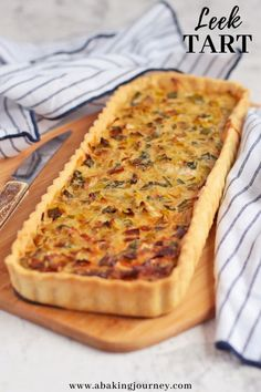 Mar 2020 - This Vegetarian Leek Tart recipe can be served at any meal and course of the day! Made with a shortcrust pastry and filled with leeks, onion and gruyere cheese, this vegetarian leek savory tart is a… Savory Pastry, Savory Tart, Savoury Baking, Savoury Tart Recipes, Savoury Pies, Shortcrust Pastry Tarts, Quiche Recipes, Pastry Recipes, Brunch Recipes