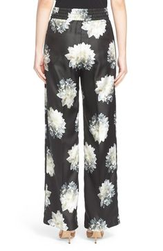 Free shipping and returns on Max Mara 'Bazar' Floral Print Wide Leg Silk Pants at Nordstrom.com. White peonies burst into bloom on lustrous silk-twill pants, bringing feminine romance to the slouchy, pajama-inspired silhouette. An elasticized, cummerbund-style waist perfects the fit while enhancing the relaxed feel.