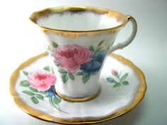 Vintage Royal Adderley Tea Cup And Saucer, White tea cup with pink and blue roses, English Bone China, Heavy gold rim.