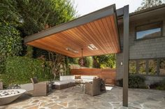 Contemporary-Concrete-Patio-Design-Decorated-by-Rattan-Seating-Covered-by-Solid-Pergola