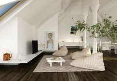 salon à aire ouverte avec revêtement de sol aspect bois, poufs poire en beige, table basse blanche et plantes vertes
