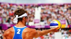 Martin Reader of Canada prepares to serve in the men's Beach Volleyball prelim match - Canada vs. Norway