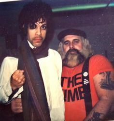 "With his body guard Big Chick Huntsberry, whom were best of friends as the story goes. It was cool how in a few photos with Chick you could see him wearing a Prince promotional T-shirt and this one he's wearing one for ""The Time"", that's one very cool rare collectible! Sadly he passed in 1990, and Prince held a benefit concert in his honor to help his family."