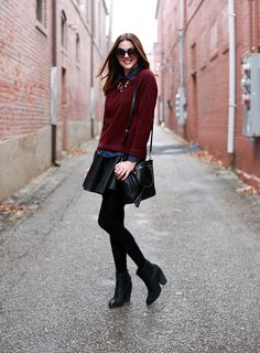 maroon sweater, chambray button up, leather skirt, black tights, black ankle booties, black purse, statement necklace