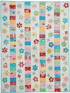 Sugar Flowers Throw--The Sugar Flowers Throw is one of the pretty nontraditional quilt patterns that combines applique and patchwork against a white background for a fresh look. Applique flowers patterns bloom between stripes of floral fabric in this free quilt pattern. Quilt Size: 58 inches wide x 75.5 inches long Pieced & Appliqued