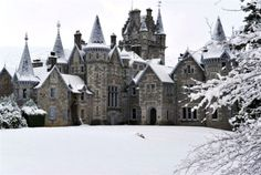 Ardverikie House in the Highlands of Scotland. LOOK AT ALL THOSE FABULOUS TURRETS AND SNOW-COVERED SPIRES,