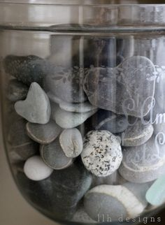 "Such a cute idea - collect heart-shaped rocks and display them in glass jar. Now if only I can find a jar with the word ""love"" etched on it!"