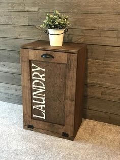 Tilt out trash bin, double trash bin with a drawer. Vist us at Lovemade14.com to design your tilt out trash bin or tilt out laundry hamper today! #farmhousestyle #kitchentrash #lovemade14 #rusticmodern #kitchengoals #trashcanstorage #laundrysorter #laundrystorage #tiltouthamper #tiltoutlaundry #handmade #mudroom #laundryroom #farmhousestyle