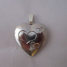 A lovely silver plated heart shaped locked with 3 hearts engraved on the outside. There's room inside for two pictures. A perfect gift for that someone special or for Mother's Day. hummingbirdmges #htlmp #britcraft #hmuk #craftbuzz #gotshop #gotshophr #readytoship #handmade #jewellery #necklace #MothersDay #ValentinesDay #locket #heart