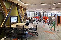 This collaboration space is trendy and modern. The neutral floors are interrupted with pops of orange Skinny Planks that match the individual workspaces / booths / desks. Fun, inviting environments make the space more enjoyable and appreciated.