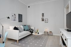 Living Room / Love this color scheme ... light grey walls, pops of color that you can switch out with the season