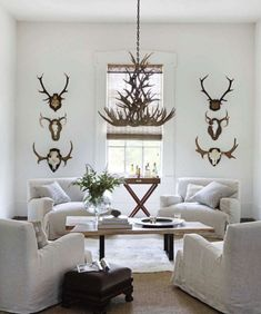 White Living Room Decorated with Antlers | from House Beautiful | House & Home
