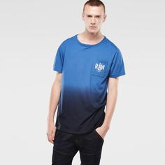 Short sleeve tee with an inserted, round neck and rectangular patch pocket. Soft binding lines the neck.