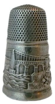 A very early pictorial Victorian s/s thimble showing the Menai bridge in wonderful detail on a very wide band and all round. Note the tall elegant narrow shape which typifies the earlier Victorian silver thimbles. A very rare thimble #sewing #thimble