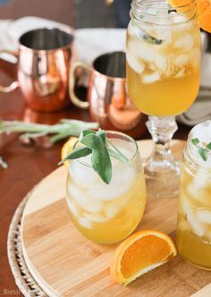 Honey bear cocktail  | It is the perfect cocktail to sip on during those chilly fall evenings with friends on your porch.  Made with a simple syrup of honey, sage, and orange, then combined with southern bourbon over ice, you will be sipping on a fresh, mellow, slightly sweet cocktail that everyone {including those honey bears!} will find perfect all fall long.  @blessherheartya