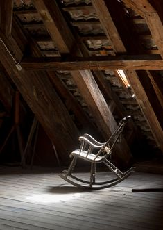 Vintage rocking chair on deserted old attic floor in Round Tower in Copenhagen, Denmark. by Polonsky Dmitry - Photo 144705193 - 500px