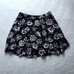 Host PickFloral Skirt Black skirt with white flowers. Zippers and hooks in the back. Worn a few times. Forever 21 Skirts Mini