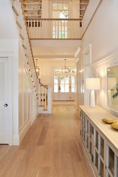 Staircase Landing. Staicase leading to upper level with built-in bookcase. Floors are white oak. Sunshine Coast Home Design. More