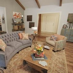 Wooden beams, grey couch, great living space