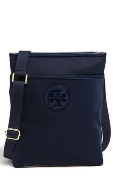 Love the classic style of this navy Tory Burch nylon crossbody bag.