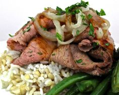 Mongolian Sirloin Steak - Roasted sirloin steak, spicy Mongolian glaze, pan fried blue lake beans, jasmine rice, grilled onions