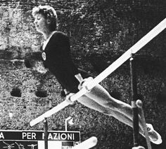 FILE - In this Sept. 8, 1960 file photo, Larisa Latynina of the Soviet Union competes at the 1960 Summer Olympics in Rome. She won the gold medal in the woman's individual gymnastics event. The gymnast whose career record for most Olympic medals was broken by Michael Phelps says she doesn't mind that the American swimmer has surpassed her mark. Latynina, who won 18 medals in the 1956, 1960 and 1964 Olympics, was at the Aquatics Centre in London on Tuesday to watch Phelps, and she says