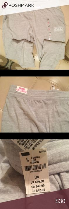 NWT Victoria's Secret PINK sweatpants NWT VS PINK light gray Skinny Collegiate sweat pants. Has slit pockets and banded at ankle. Very soft fabric Victoria's Secret Pants Track Pants & Joggers