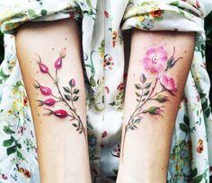 Flowers tattoo by Pissaro Tattoo