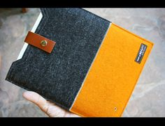 macbook 13 sleeve case - charcoal and orange wool felt sleeve. $58.00, via Etsy.