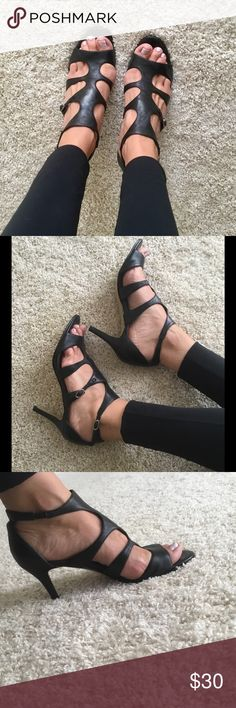 Strappy, low heel black sandals Black, soft-leather sandals with the perfect heel - not too high, not too low. Comfortable to wear with clasps on one side. Worn a few times, but still in great condition. Nine West Shoes Sandals