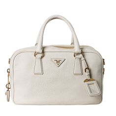 @Overstock - The Vitello Daino satchel from Prada combines structured vintage elements with contemporary design. This satchel is constructed with pebbled leather, and features a hanging ID tag, a functioning lock and key, and stylish goldtone hardware. $1,299.99