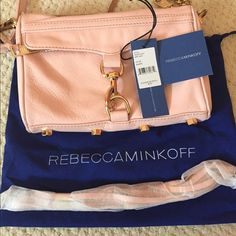 AUTHENTIC Rebecca Minkoff Mini Mac Used with tags, authenticity card, and dust bag. Pretty in pink for spring & summer! Used, but in good condition.  Slight markings on the front and back of bag.  1 compartment with pocket on backside. Zipper closure.  *Extra tassels included!* Rebecca Minkoff Bags Crossbody Bags