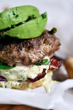 The most delicious LEGIT Paleo bacon avocado burgers! Loaded with fresh basil and garlic. Topped with a creamy white sauce and red onion. Plus, these fluffy and soft grain free buns are to die for! Check out the whole30 burger option too! Paleo burger recipe. Paleo burger patties. Paleo beef burgers. Paleo meal plan. Easy paleo dinner recipes. Easy whole30 dinner recipes. Whole30 recipes. Whole30 lunch. Whole30 meal planning. Whole30 meal prep. Healthy paleo meals. Healthy Whole30 recipes…