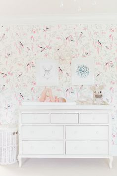 This nest nursery is adorable, complete with whimsical bird wallpaper!