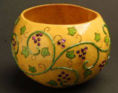 """Jeweled Grape Vine Bowl   by Karen Hundt-Brown  This small gourd bowl was Green cleaned. The #Grape vine pattern was channel set and each of the #Purple Grape crystals were hand set into divots hand drilled into the skin of the gourd.   Size: 7""""W x 5""""H  Price: $70.00  On Artful Vision, www.artfulvision.com a portion of your purchase is donated to a participating non-profit of your choice. #home #art #bowl #gift #decor"""