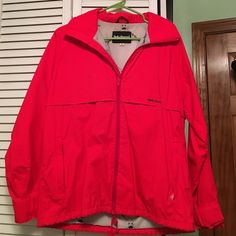 Helly-Hansen red zip up Red Helly-Hansen zip up, size medium, nylon material. Small black mark on right sleeve (shown in picture) Helly-Hansen Jackets & Coats Utility Jackets