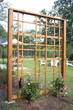 Build a DIY garden trellis that& as beautiful covered in flowers as it is without. It& an intriguing design that might look complicated but is so easy to replicate. Here& how to make your own DIY garden trellis. Bamboo Trellis, Diy Trellis, Garden Trellis, Trellis Ideas, Flower Trellis, Trellis Fence, Herbs Garden, Fruit Garden, Trellis Design